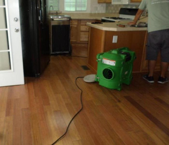 Wood Floor Repaired After Storm Damage After