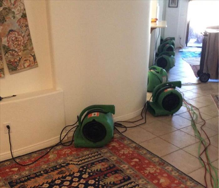 Air movers in living room area.