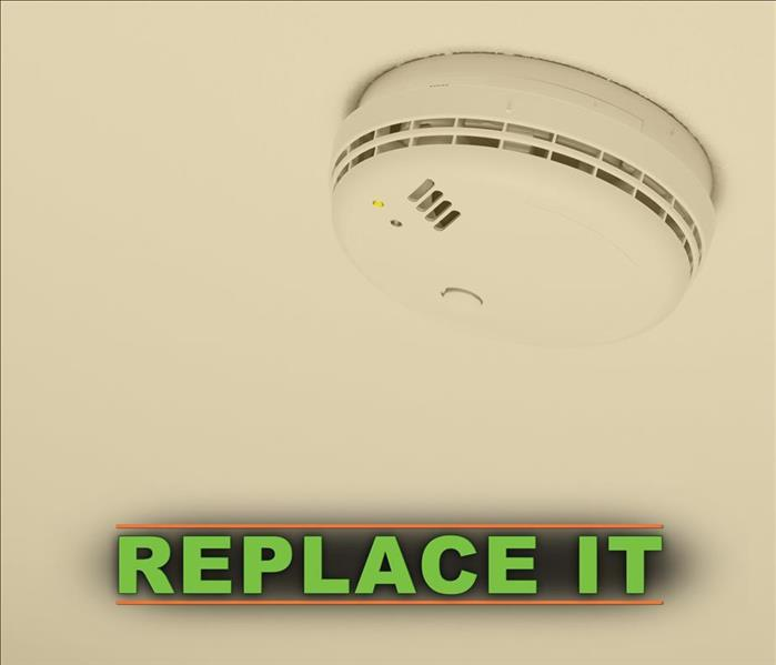 Smoke alarm with the phrase REPLACE IT